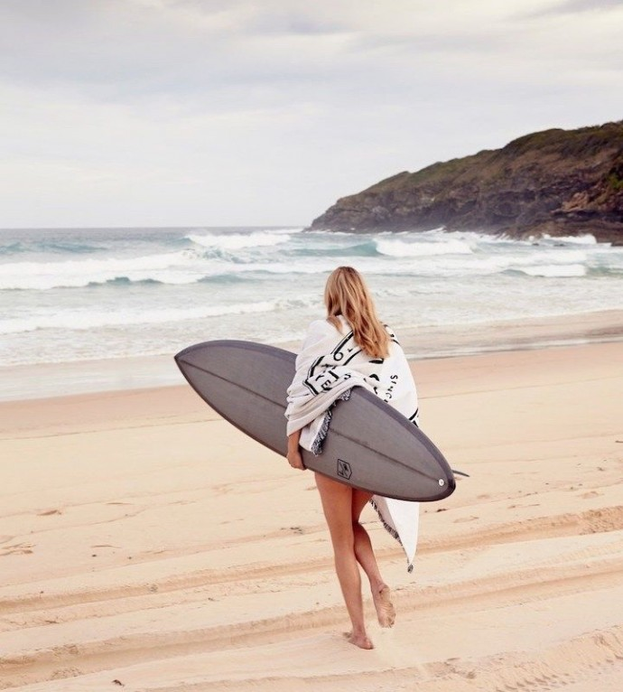 surfing girl on the beach